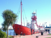 cardiff-bay-lighthouse-boat-and-church-blake-anforth