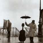 musician-in-the-rain-doisneau