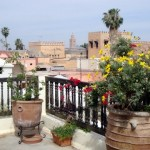 Rooftop terrace at Riad Diana with Koutoubia Mosque in the distance