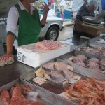 A negotiation over fresh fish at the Marsaxlokk Market