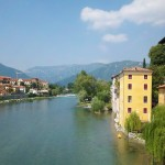 Pristinely kept pastel-colored buildings dot the Brenta River