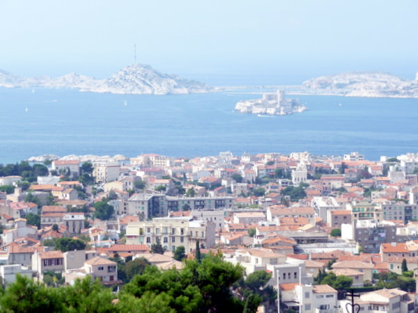 Red tiled roofs of Marseille overlooking the historic Chateau d'If