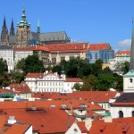 view across prague's rooftops to the castle