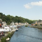 The picturesque port of Dinan looking down-river from the stone bridge