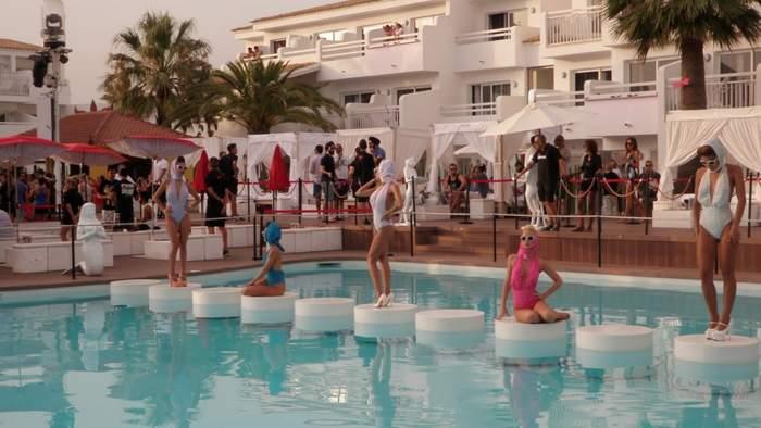 Women displayed in an Ibiza pool