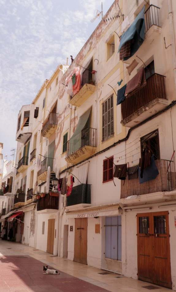 Laundry hanging from windows in Ibiza Town