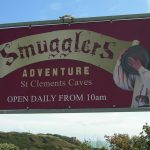 Sign for the smugglers adventure St. Clements Caves, Hastings.