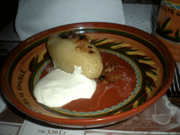 Cepelinas, a boiled potato pastry that is literally not for the faint of heart
