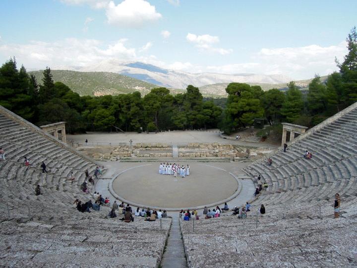 Watching a play at Epidaurus