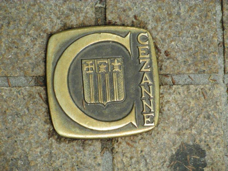 Bronze plaque in pavement for following Cezanne trail