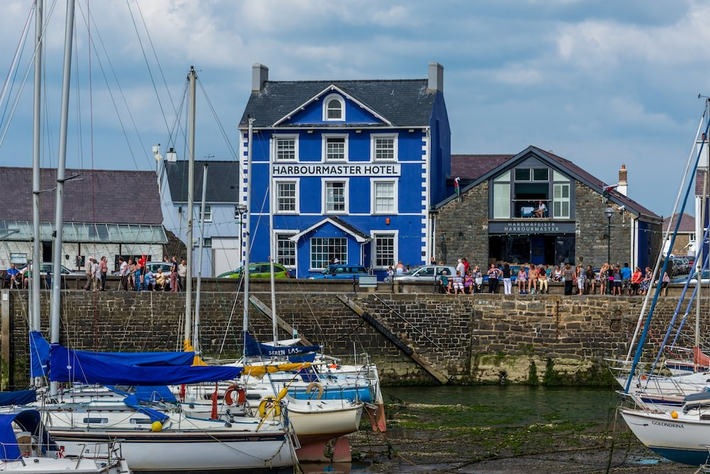 People enjoying a few brews outside the Harbourmaster Hotel at Aberaeron.