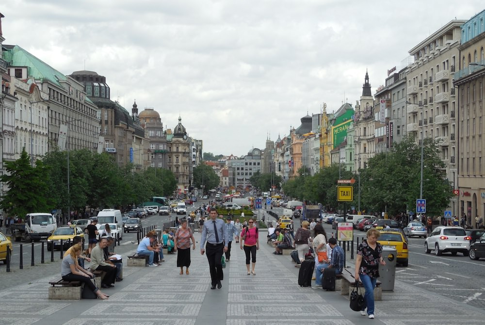 Wencelas Square today, full of tourists, color, and Western goods for sale