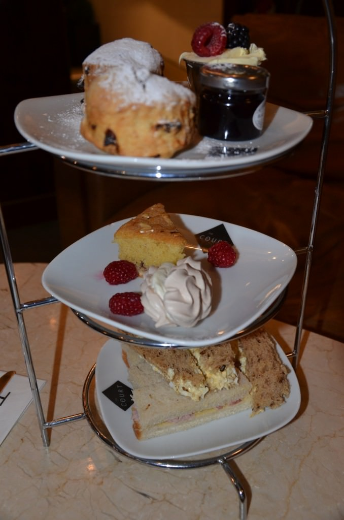 My High Tea was Served on a Three-layered Metal Stand. Thick Moist Sandwiches (without Crusts, of Course) Crammed with Egg Salad, Asparagus, Ham, and Other Deli Treats.