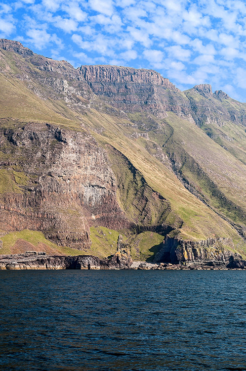 The Ross of Mull, Mull's southerly peninsula, is best seen from the sea. Here are the Carsaig Arches – a tumble of rocks and caves with a sea stack at the base of the cliffs, above which golden eagles soar.