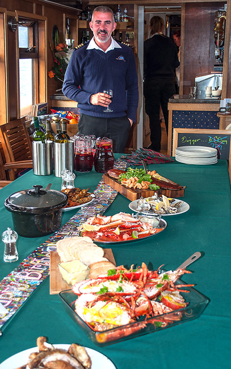 A surprise birthday buffet with Captain Sandy – all the seafood on board is so fresh it shocks my taste buds.