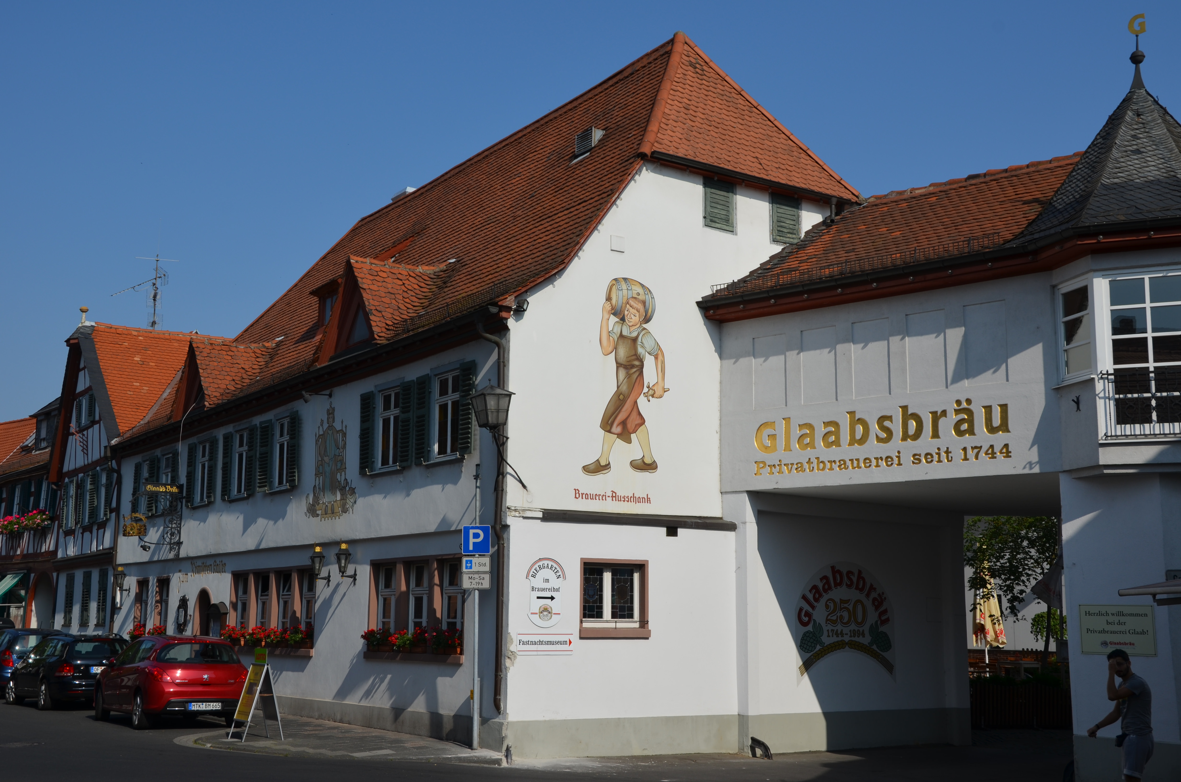 The Glaab brewery is housed in an immaculate, white, two-story building with a red-tiled roof.