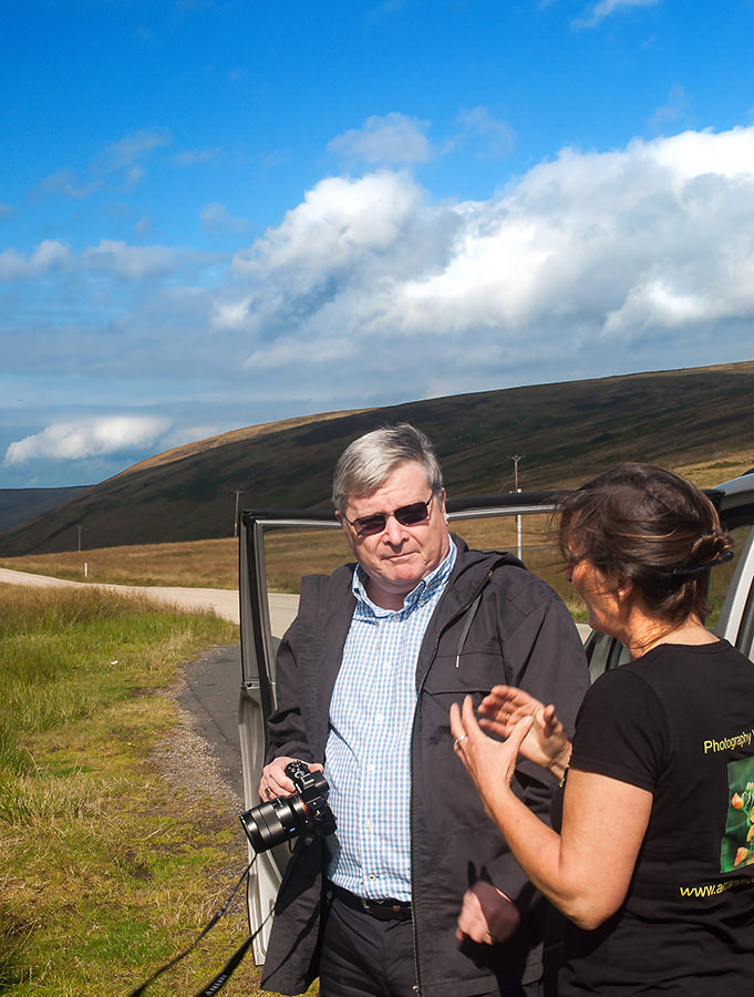 Jackie Newman of Arran in Focus showing my husband James one of the finer points of photography.