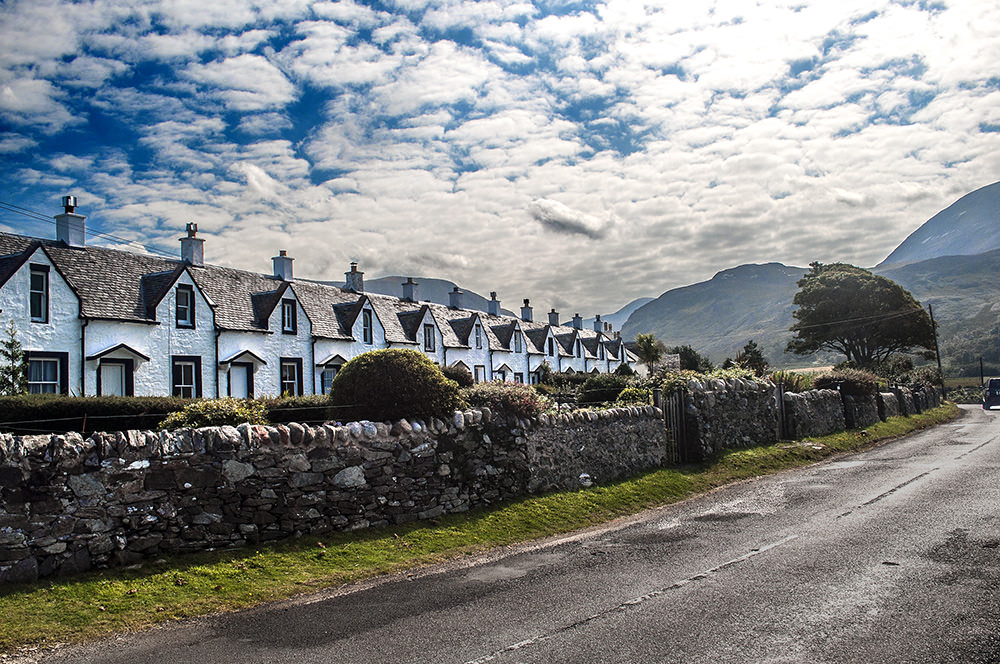 Formerly tithed parish cottages, the Twelve Apostles are a favourite photo op on the west coast. They have a spectacular view across to Kintyre.