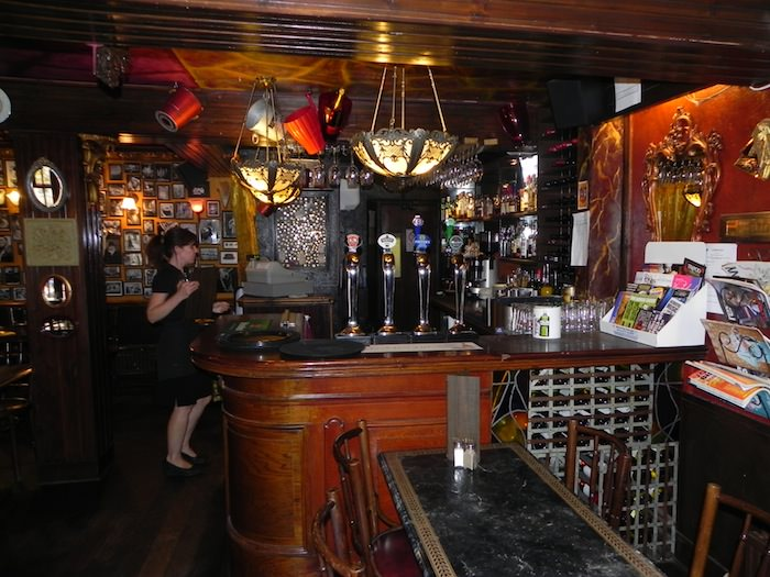 The 1780 is a nicely appointed bar with plush wallpaper and beautifully decorated