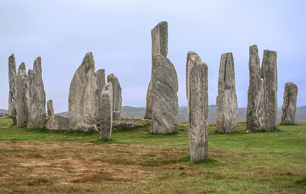 In high season the main circle of the Calanais Standing Stones is fenced off for visitors, but at the end of September we wandered freely among the stones. In the centre is a chambered cairn (tomb) that was added later, maybe 500 to 700 years after the circle was built.