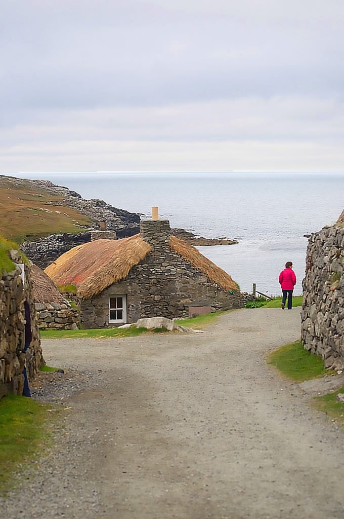 The restored blackhouses at Gearrannan are all below grade and thatched with straw and reeds held down by the mesh from fishing nets and stones.
