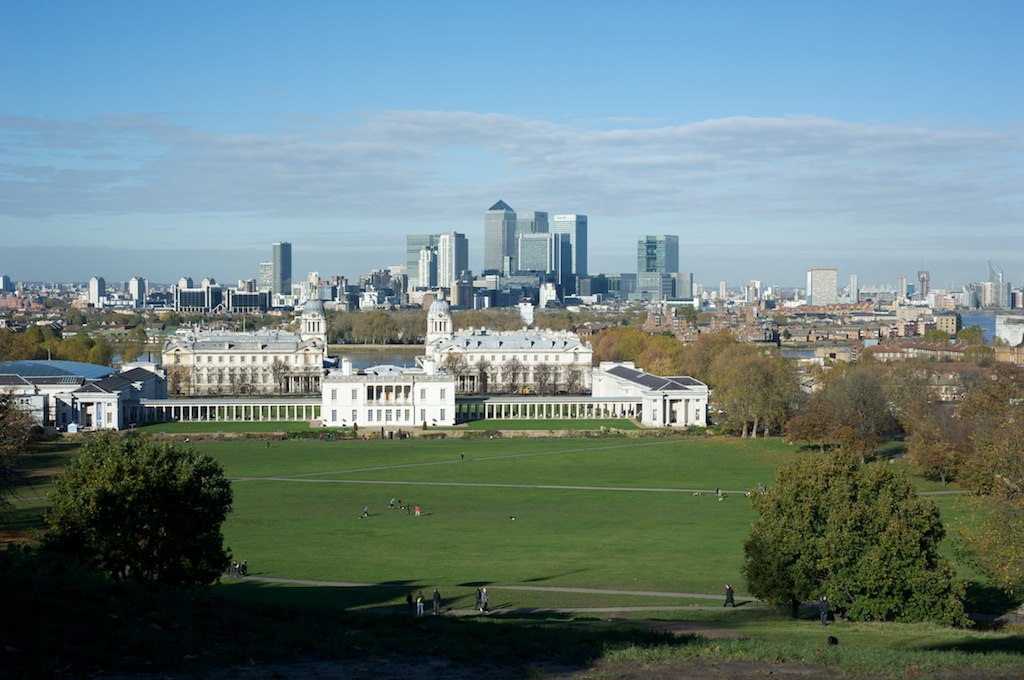 The grand buildings of Greenwich contrasted with the skyscrapers of Canary Wharf on the other side of the river