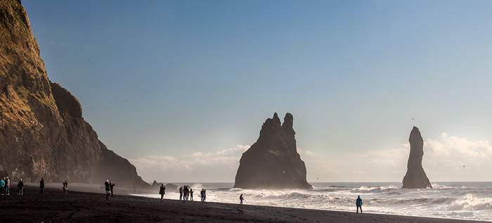 The black sand beach and rock formations at Reynisfjara are the most popular and photogenic stops on the South Shore tour.
