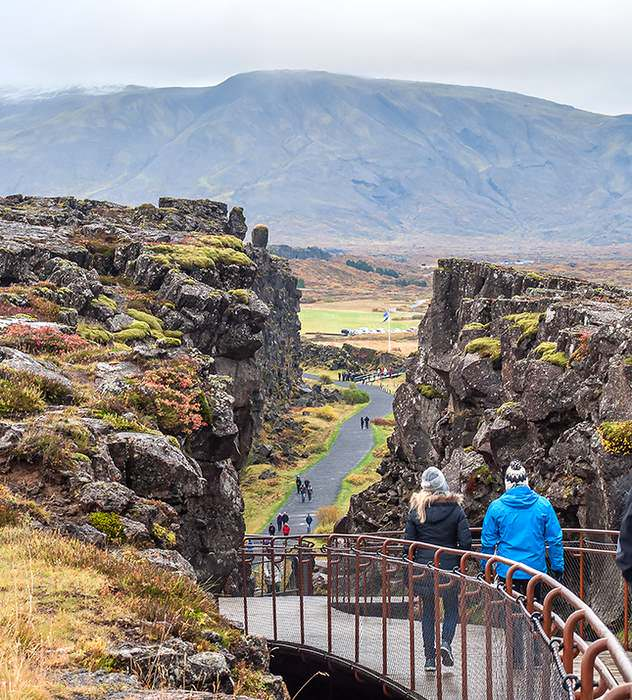 "Beyond the rock cleft at Pingvellir lie fields known as the ""Parliament Plains"" where Icelanders assembled every June until 1799. Today the parliament meets in Reykjavik."