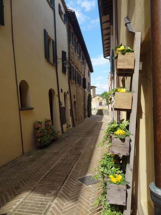 Solomeo's flower-decked streets blossom most vividly in the warm months.
