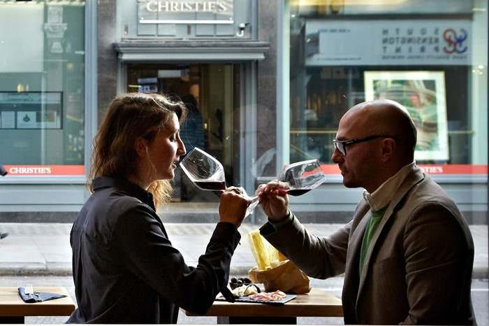 enjoying a glass of wine at vivi Italiani