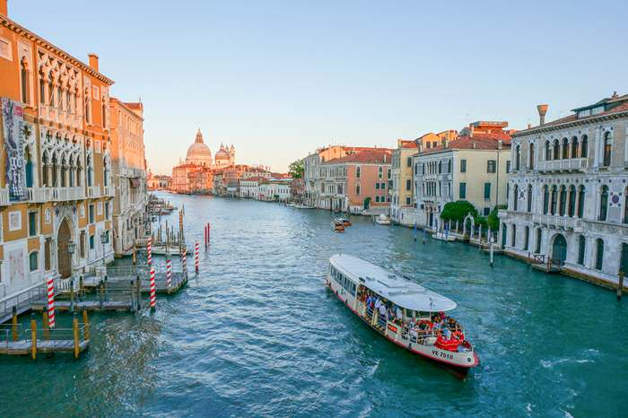 Vaporetto travels along the Grand Canal at sunset n Venice