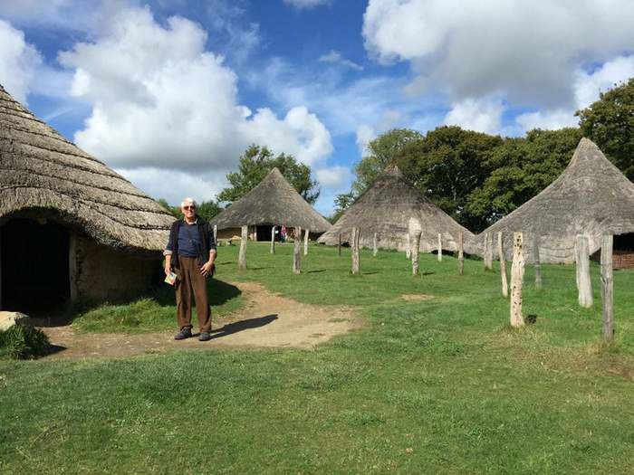 Thatch-roofed houses at Castell Henlyss, a replica of an Iron Age village in Wales