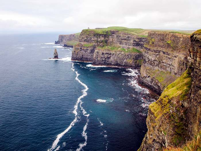 Waves crashing into the Cliffs of Moher